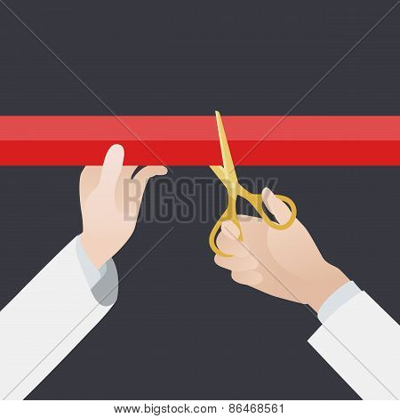 Hand with golden scissors cut the red ribbon