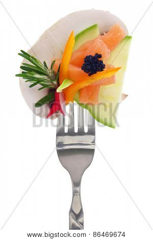 Colorful vegetables, salmon and caviar on fork, isolated on white