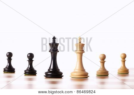 black and white chess pieces standing on a chessboard