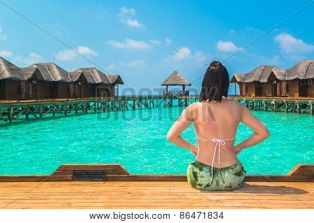 Woman is relaxing on the tropical beach, Maldives