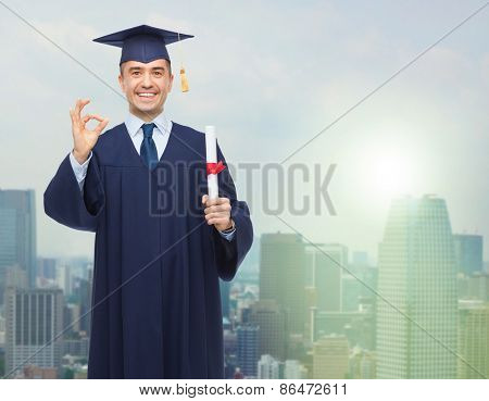 education, graduation, gesture and people concept - smiling adult student in mortarboard with diploma showing ok hand sign over city background