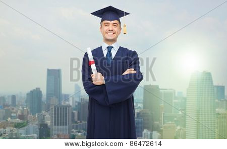 education, graduation and people concept - smiling adult student in mortarboard with diploma over city background