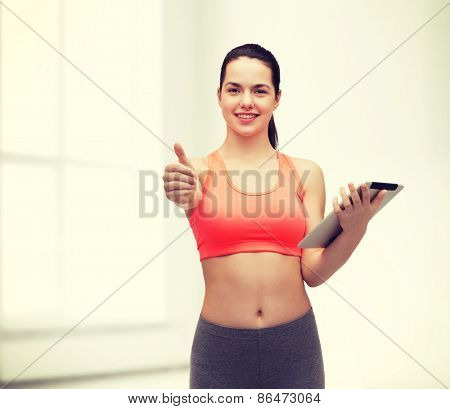 sport, exercise, technology, internet and healthcare - sporty woman with tablet pc computer showing thumbs up
