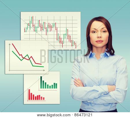 business and education concept - friendly young businesswoman with crossed arms