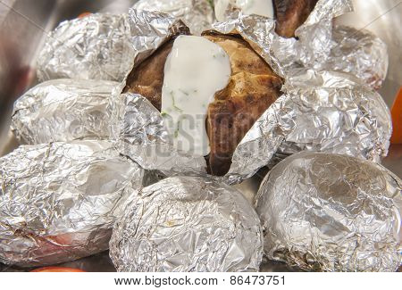 Baked Potatoes In Foil At A Buffet