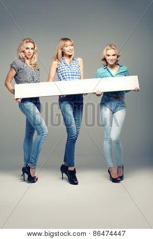 Three Girls With Empty Board.