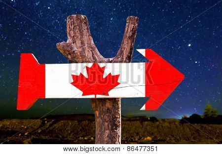 Canada wooden sign with a beautiful night