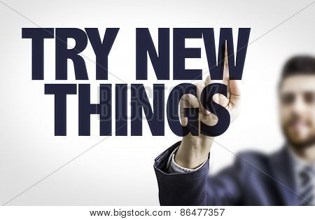 Business man pointing the text: Try New Things