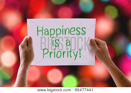 Happiness is a Priority card with bokeh background