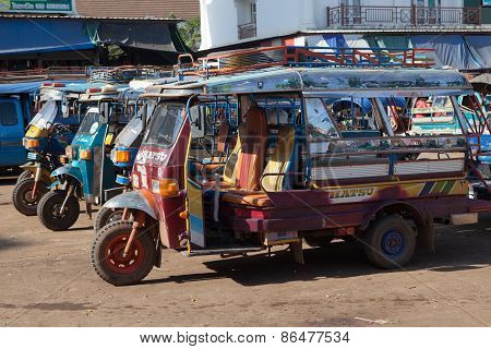 Laos Champasak-nov23:laos Three Wheel Vehicle Waiting For Passenger In Champasak Morning Market  In