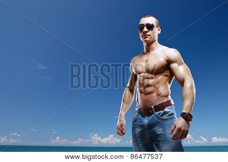Guy On The Beach With Sunglasses