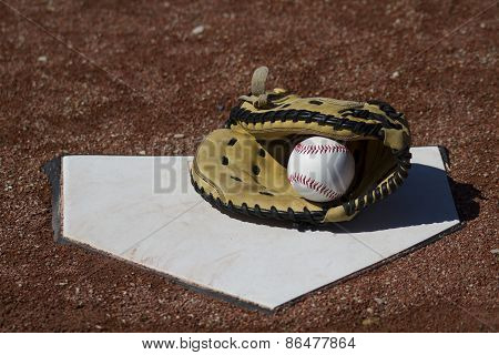 Baseball Catchers Mitt With White Baseball On Homeplate