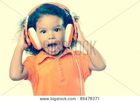 Instagram toned small girl listening to music on her big headphones