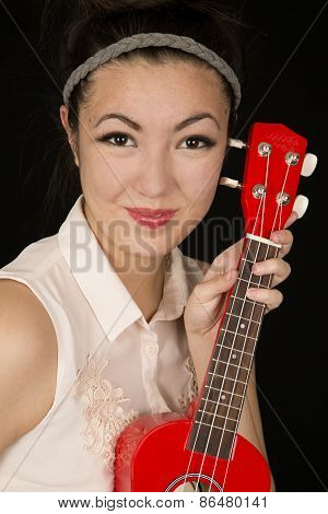 Asian Amerian Teen Girl Protrait With A Red Ukulele