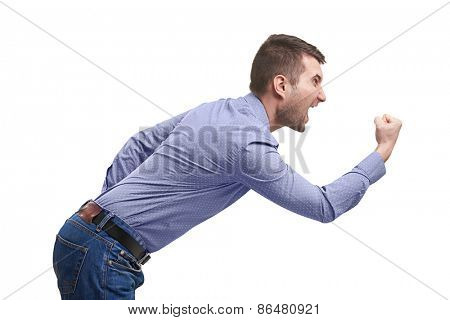 sideview of screaming man with fist. isolated on white background