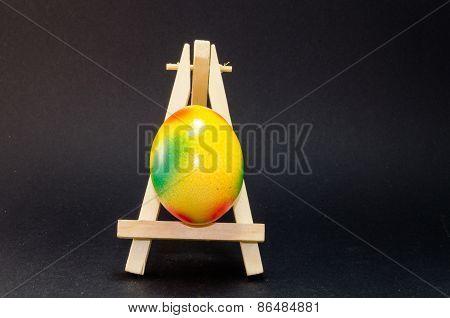 Easter Egg On Artist Easel, Black Background