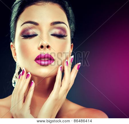 Model with trendy makeup ,Smokey eyes , fuchsia lips and nails .