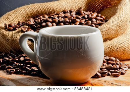 Closeup Of Invigorating Drink In A Cup And Coffee Beans