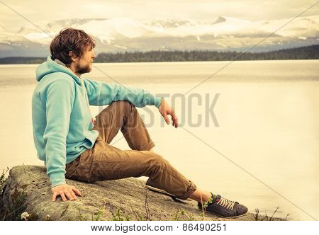 Man Traveler relaxing alone outdoor Lifestyle Travel concept