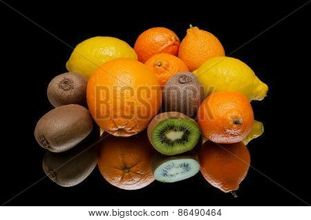 Still Life Of Tropical Fruits On A Black Background