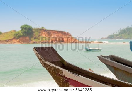 Untouched tropical beach and fishing boats in Sri-Lanka