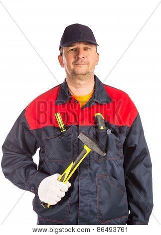 Worker holding hammer.