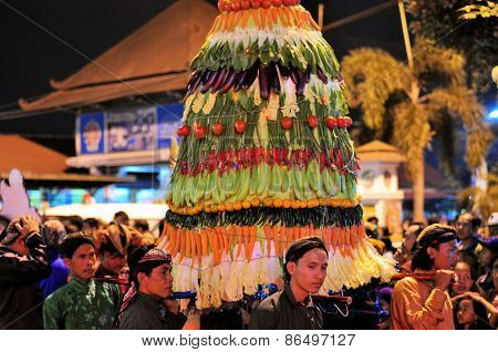 Men carry tower of vegetables, Yogyakarta city festival parade
