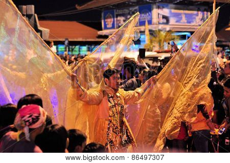 Men are costumed like angels, Yogyakarta city festival parade