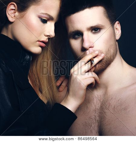 woman leaning on her man looking at the camera