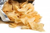 picture of kettling  - Bag of kettle chips spilling over on a white background - JPG
