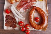 foto of deli  - Assortment of deli meats on parchment - JPG