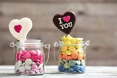 picture of glass heart  - Sweet candies in glass jar with hearts on wooden background - JPG
