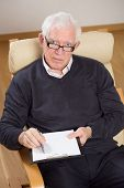 stock photo of psychologist  - Vertical view of senior experienced listening psychologist - JPG