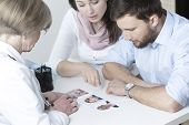 foto of vitro  - Couple choosing characteristic of their future child from in vitro - JPG