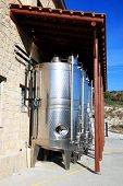 foto of fermentation  - Modern metal stainless steel wine vat casks fermenting grapes - JPG