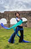 foto of aqueduct  - blue belly dancer under the Roman aqueduct - JPG