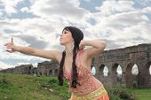 pic of aqueduct  - belly dancer with ancient Roman aqueducts ruins in the background - JPG