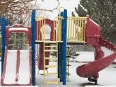 image of snow-slide  - Playset in winter snow falling and no children to play slide monkey bars and ladder - JPG