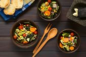 pic of sweet-corn  - Overhead shot of three rustic bowls of baked vegetables  - JPG