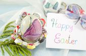 foto of decoupage  - Handmade decoupage Easter egg on a handmade paper plate with a Happy Easter card - JPG