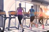 image of treadmill  - group of young people running on treadmills in modern sport  gym - JPG