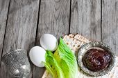 stock photo of bitters  - Wine egg bitter salad leaves matzot and haroset  - JPG