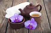stock photo of black tea  - Asian tea set with orchid black tea on a wooden background - JPG