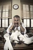 stock photo of 1950s style  - Desperate accountant shouting head in hands in vintage 1950s style office - JPG