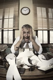 image of 1950s style  - Desperate accountant shouting head in hands in vintage 1950s style office - JPG