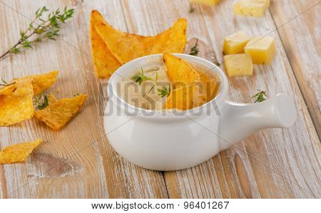 Cheese Sauce With Nachos On  A Wooden Table.