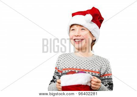 Portrait of a boy in christmas hat holdink white blank. Isolated