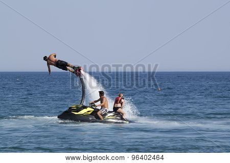 Unidentified Turkish Man Demonstrates Flyboard Acrobatics On The Beach Of Camyuva