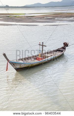Fishing Boats At Low Tide  Sunset Background,phuket,