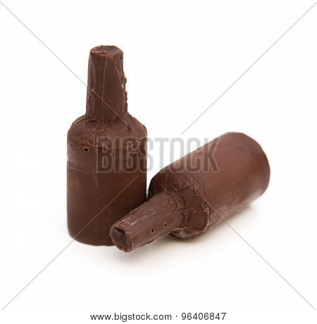 Two Pieces Alcohol-filled Chocolate On A White Background